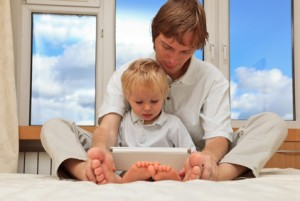 father and son with touch pad
